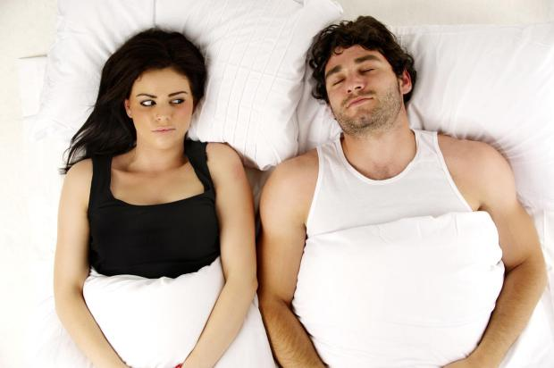 man-and-woman-laid-in-a-white-bed